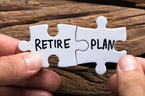 matched puzzle pieces that say retire and plan