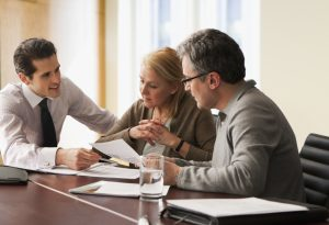 advisor going over paperwork with older couple